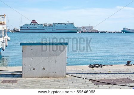 Quay with copy space box and Acciona Trasmediterranea ferry Fortuny