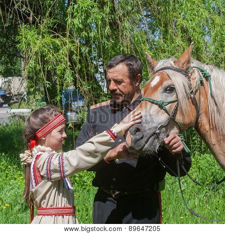 Makeevka, Ukraine - May, 7, 2014: Male Cossack And A Girl In National Costume During The Celebration