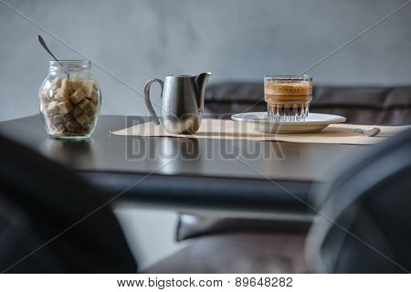 Coffee espresso on black glossy table.