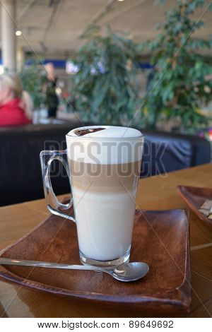 Latte Macchiato In Glass Cup On The Wooden Table
