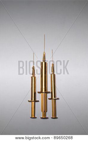 Gold syringes
