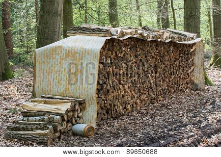 Tree Logs Piled Up Under A Roll Covering