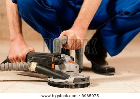 Sanding the cement floor