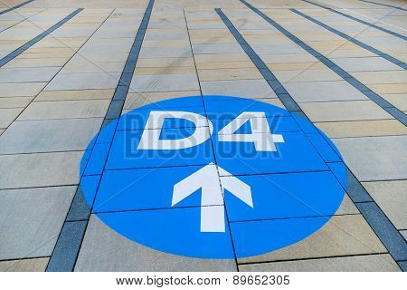 blue arrow on pavement slabs, symbol of orientation, clarity and information