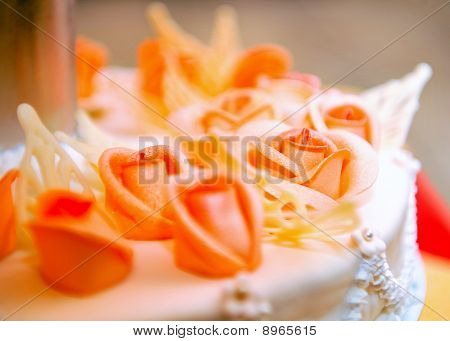 Beautiful Wedding Cake In Orange Tones With Rose Flowers