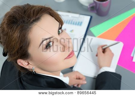 Portrait Of Beautiful Business Woman At Workplace Looking Back