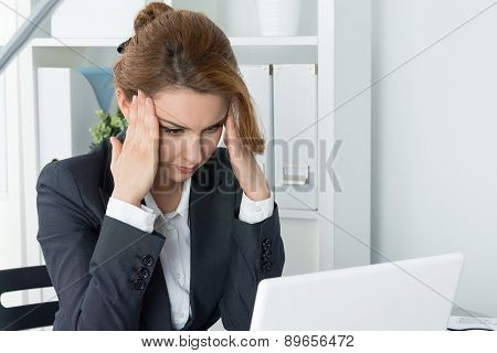 Young Beautiful Business Woman Trying To Concentrate