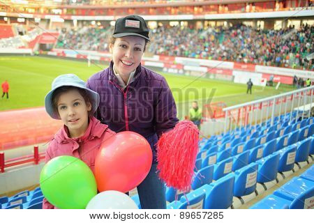 MOSCOW- MAR 10, 2014: Portrait of happy mother with daughter at the Lokomotiv Stadium