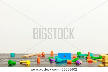 Multicolored Toy Blocks On Wooden Table