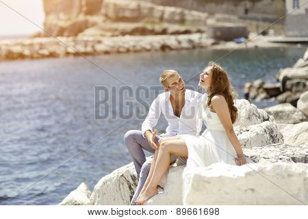 Young Couple Bride And Groom Smiling And Relaxing Near Sea, Naples, Italy