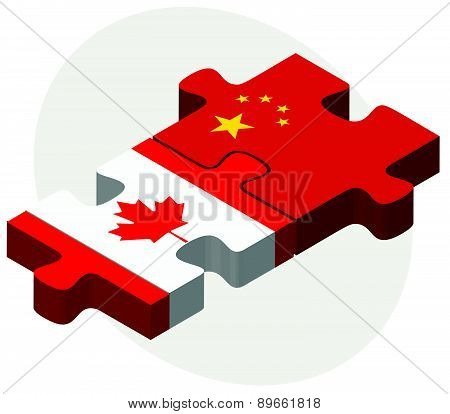 Canada And China Flags In Puzzle
