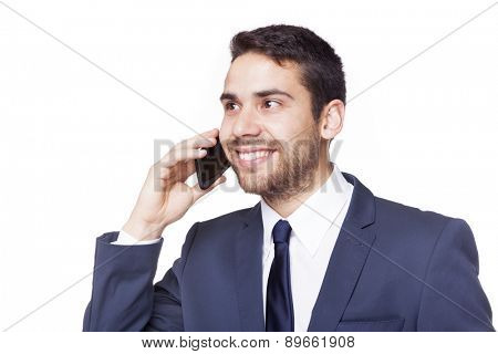 Happy smiling business man talking on the phone, isolated on white background
