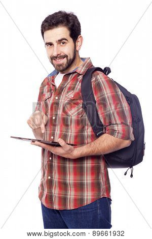 Casual smiling student holding a tablet pc, isolated on white background