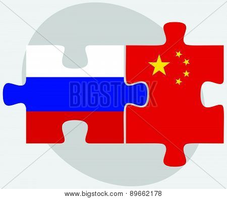 Russian Federation And China Flags In Puzzle