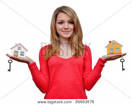 Girls holding in hands house and key on white background