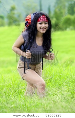 Attractive Woman Hiking To Mountain Peak
