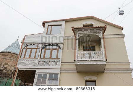 House with traditional balcony in Tbilisi. Old city