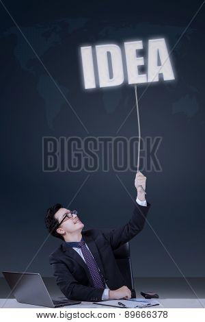 Businessperson Pulls An Idea Text