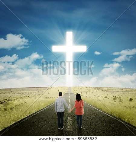Happy Couple On The Road With A Cross