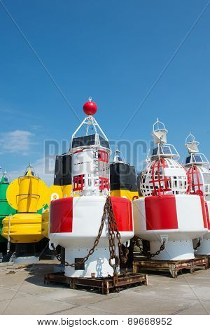 Many colorful sea buoys in stock