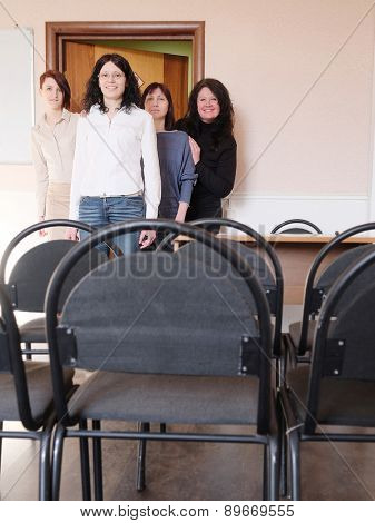 Group of womans enters a education class