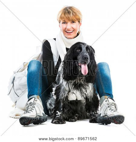 modern woman with her dog cocker spaniel in a studio isolated on a white background