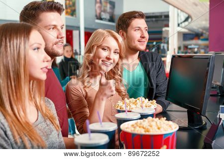 Group of people buying popcorn and drinks