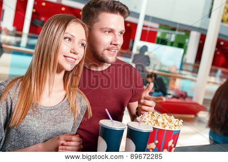 Couple buying popcorn and drinks