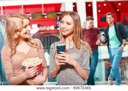 Two girls with coke and popcorn