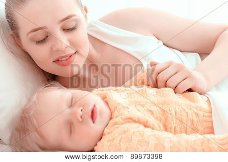 Sleeping baby and his mother