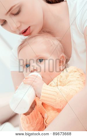 Mother and her  little baby with the bottle