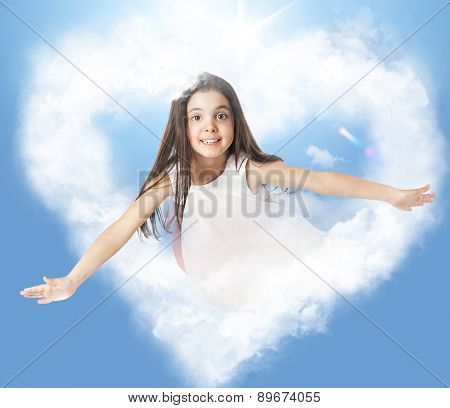 Little girl flying through a heartshaped cloud