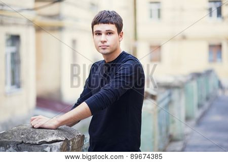 portrait of a young attractive man in city