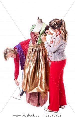 Dressmakers Making A Dress