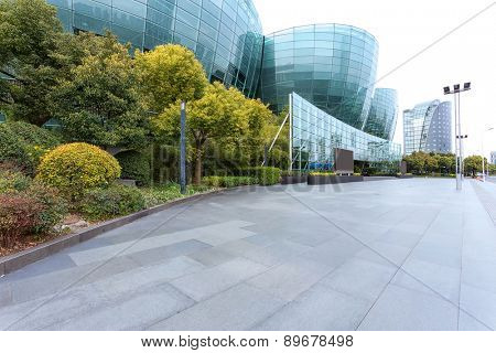 Empty road near modern building exterior