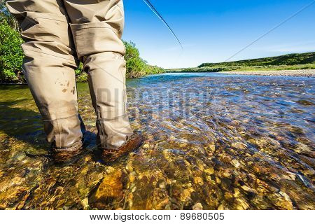 A Person Fly Fishing On A River