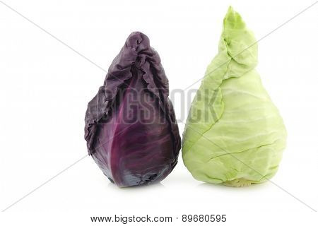 a red and a green pointed cabbage on a white background