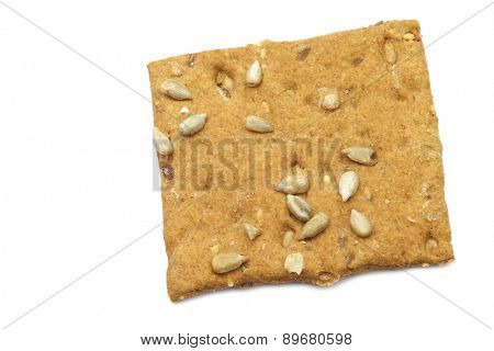 crispy spelt cracker with sunflower seeds on a white background