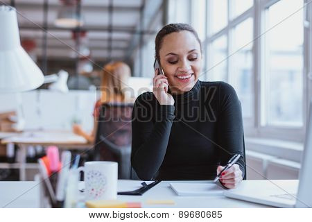 Woman Answering A Phone Call While At Work