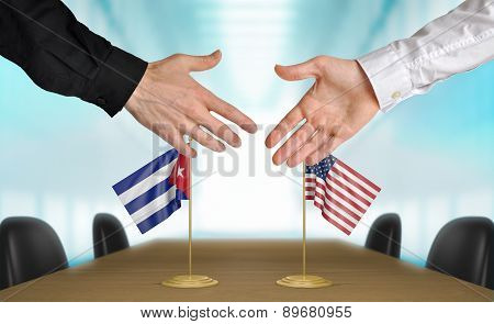 United States and Cuba diplomats agreeing on a deal