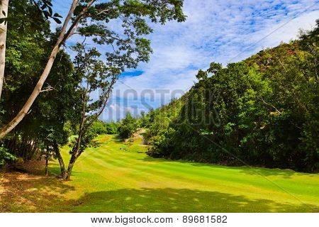 Golf field at island Praslin Seychelles - nature background