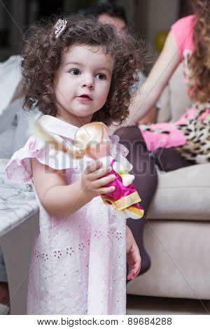 Girl Playing With A Doll