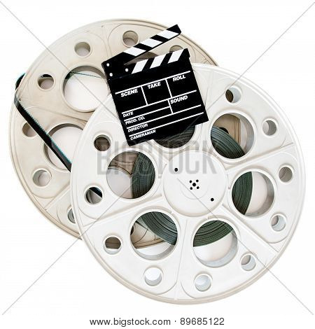 Movie Clapper On Two 35 Mm Cinema Reels With Film Isolated