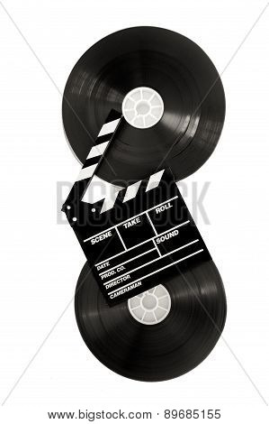 Movie Clapper On 35 Mm Cinema Film Reels Isolated Vertical