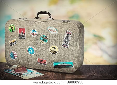 Retro Suitcase With Stikkers On The Floor
