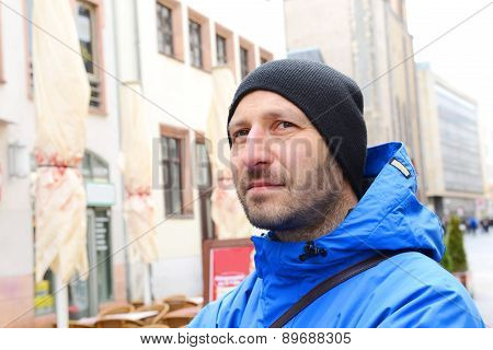 Man With Cap In Front Of City Background