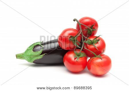 Bunch Of Ripe Tomatoes And Eggplant Close Up On A White Background