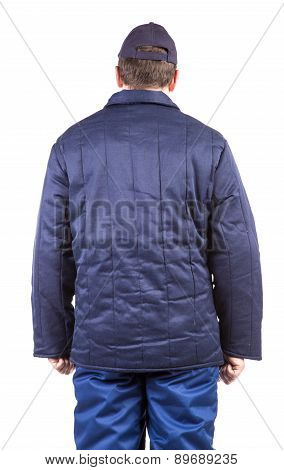 Worker in winter workwear. Back view.