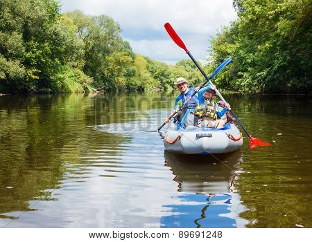 Girl with her mother kayaking