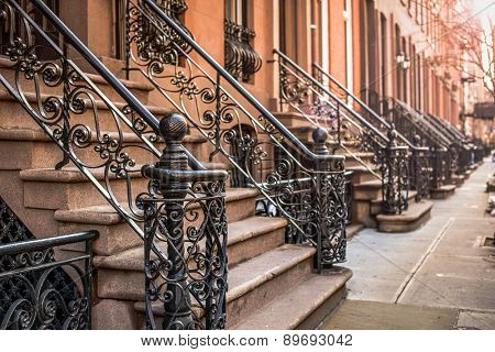 Brownstone apartment building entrances in New York City.